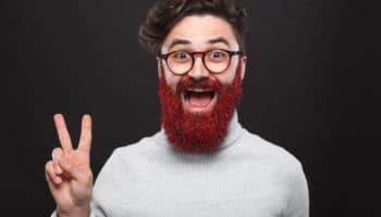 Cheerful man with glistening beard gesturing